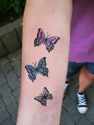 Small Butterfly Tattoos On - colorful small butterfly on arm tattoomagz