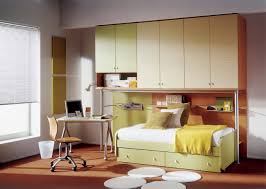 modern bedroom for kids with nice storage and study area
