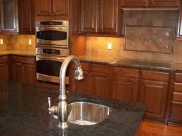 neutral kitchen with mahogany kitchen set also slate backsplash