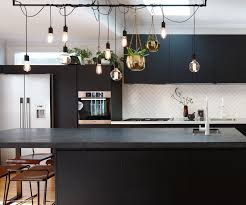 black and white textures add drama to this light filled kitchen
