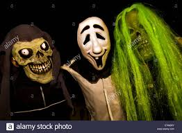 free for halloween three people dressed up for halloween stock photo royalty free