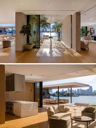 a new modern waterfront home arrives in miami contemporist inside the main floor of this modern house the kitchen and a small sitting area