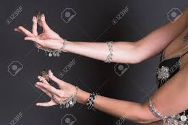 Finger Tribal - belly dancer holding tribal zagat or finger symbols stock