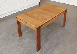 olten extending dining table with drawer in oak finish vdc04c