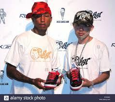 Japanese Designer by U S Hip Hop Artist Pharrell Williams L And Japanese Designer