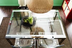 ikea glivarp extendable table a birds eye view of a pendant light hung over an ikea dining table