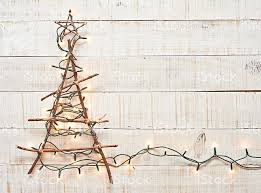 rustic christmas rustic christmas tree lighted on textured wood background stock