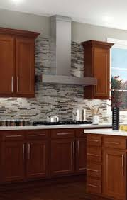 menards kitchen backsplash glenwood beech cabinets with the black alicante counters and