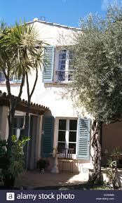 French Country House Exterior Of French Country House With Pale Blue Shutters Stock