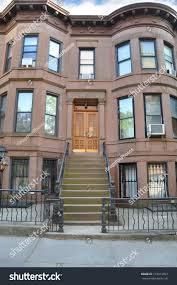 brownstone residence building steps leading door stock photo