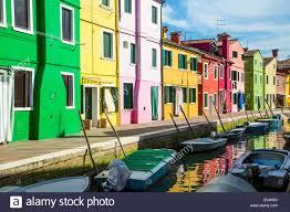 Burano Italy Row Of Brightly Colored Homes In Burano Italy Stock Photo
