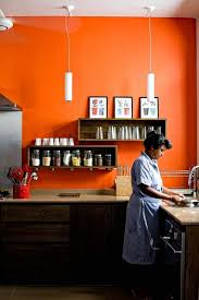 kitchen orange accent wall with dark lower cabinets that recede