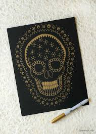 gold on black skull drawing for halloween art for kids and robots