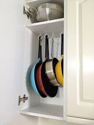 kitchen cabinet storage solutions diy pot and pan pullout 7 diy ways to organize pots and pans in your kitchen cabinets