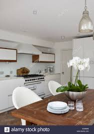 modern kitchen pendant lighting orchid on wooden table with pendant lighting in modern kitchen of