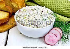 Cottage Cheese Singles by Cottage Cheese Slices On A Wooden Board Decorated With Tomato And