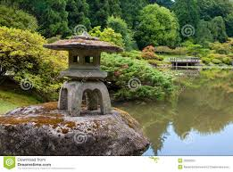 Japanese Garden Lamp by Ancient Lantern On The Pond In Japanese Garden Stock Image Image