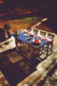 the island cabinet is the centerpiece of the outdoor kitchen