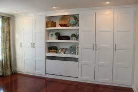 bedroom bedroom closet ideas gray armchair and ottoman green wall