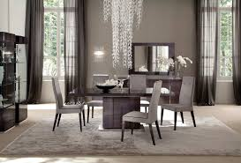 dining room table black black leather padded seats area black stained cement floor small