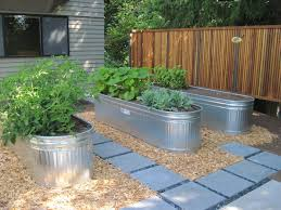 Corrugated Metal Planters by Galvanized Water Trough Planters U2022 Nifty Homestead