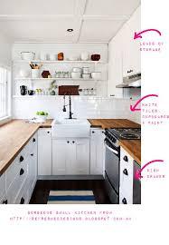 really small kitchen ideas small kitchen with white splashback tiles wooden floor white