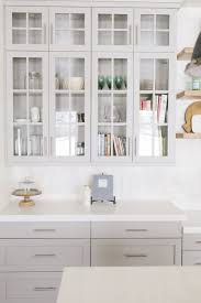 white kitchen cabinet with glass doors a touch of glass best cabinets