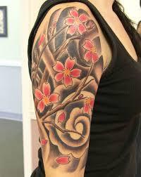 cherry blossom half sleeve ink piercings