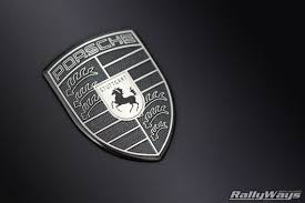 porsche stuttgart monochromatic porsche emblem close up rallyways