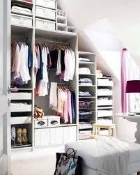 built in wardrobe and chest of drawers in an attic room to make