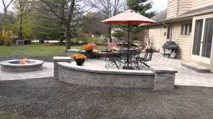 Unilock Fire Pit by Unilock Patio With Decorative Walls And A Fire Pit Youtube