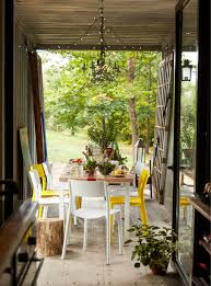 an indoor outdoor dining space in a self built home