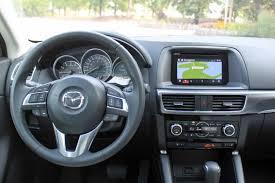mazda dashboard 2016 mazda cx 5 vs 2016 hyundai tucson autoguide com news