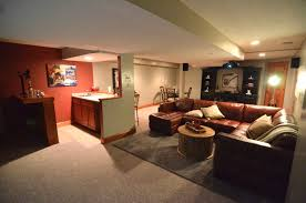 basement home theater design with cozy seating and mini bar idea