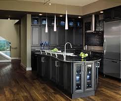 these dark grey kitchen cabinets have an artful blend of