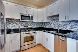 wood countertops white kitchen black backsplash pattern tile