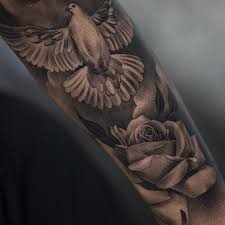 flower and flying dove tattoos on arm sleeve