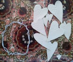 diy valentines decoration with a doily and a coathanger lulastic