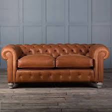 brown leather sofa in traditional living room design ideas with