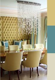 Juxtaposed Contemporary Crystal Chandelier In A Traditional - Dining room crystal chandelier