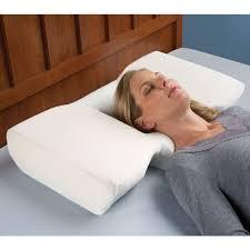 best bed pillows for neck pain the neck pain relieving pillow hammacher schlemmer