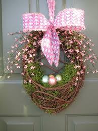 how to make an easter egg wreath easter egg door basket easter egg wreath by celebrateanddecorate