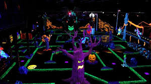 adult mini games 18 holes of indoor glow in the dark monster themed mini golf