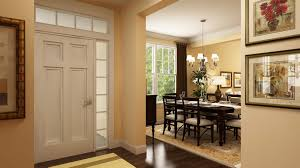 windows at the front entry accent the hardwood floors at the foyer