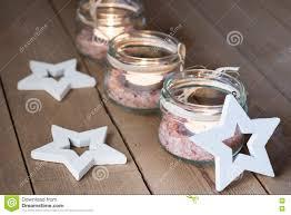 handmade tea lights in jars with salt wood decoration stars