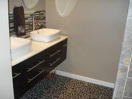 black flat pebble tile flooring modern bathroom hawaii by