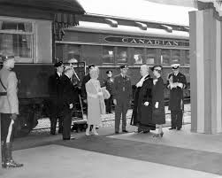 king george vi and queen elizabeth being greeted by mayor and mrs