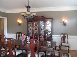 dining room double sconces with large cabinet in between for
