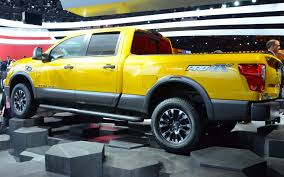 yellow nissan truck nissan wants you to mod their titan the car guide