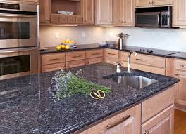 kitchen brown granite kitchen counter also wooden storage